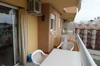 Het balcon op de zonzijde .