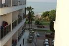 Uitzicht naar het strand vanaf balkon