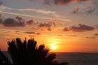 Ondergaande zon, vanaf ons balkon met zeezicht
